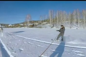 Watch How Russians Use Horses to Snowboard